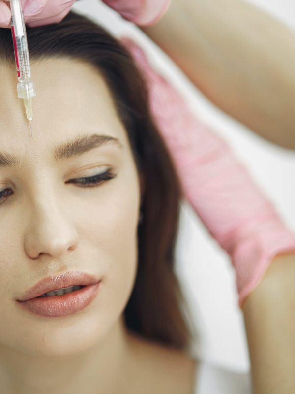 woman-getting-a-face-botox-3985311